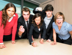 Angry Businesspeople in Meeting --- Image by © Morgan David de Lossy/Corbis